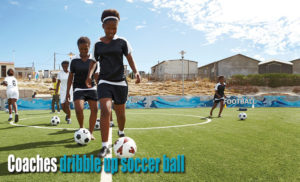 Coaches With Concurrent Goal Training dribble up soccer ball
