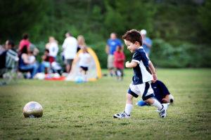 Soccer kid kicking soccer ball